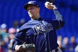 Tampa Bay Rays starting pitcher Blake Snell works against the Toronto Blue Jays during third-inning baseball game action in Toronto, Sunday, Sept. 23, 2018. (Frank Gunn/The Canadian Press via AP)