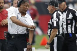 Arizona Cardinals head coach Steve Wilks argues a call with referee Greg Gautreaux (80) during the first half of an NFL football game against the Washington Redskins, Sunday, Sept. 9, 2018, in Glendale, Ariz. (AP Photo/Ross D. Franklin)