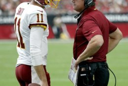 Washington Redskins quarterback Alex Smith (11) talks with head coach Jay Gruden during the first half of an NFL football game against the Arizona Cardinals, Sunday, Sept. 9, 2018, in Glendale, Ariz. (AP Photo/Rick Scuteri)