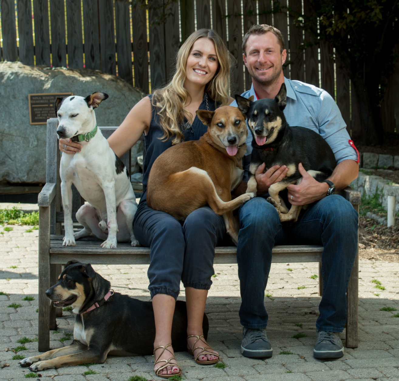 "The Nats' Max Scherzer and his wife, Erica, are featured in the Humane Rescue Alliance's new book, ""Dogs, Cats, Sports."" (Courtesy Humane Rescue Alliance)"