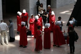"""Demonstrators protesting against Supreme Court nominee Brett Kavanaugh, wear costumes from the show """"The Handmaid's Tale,"""" during his confirmation hearing with the Senate Judiciary Committee on Capitol Hill, Tuesday, Sept. 4, 2018, in Washington. (AP Photo/Jacquelyn Martin)"""