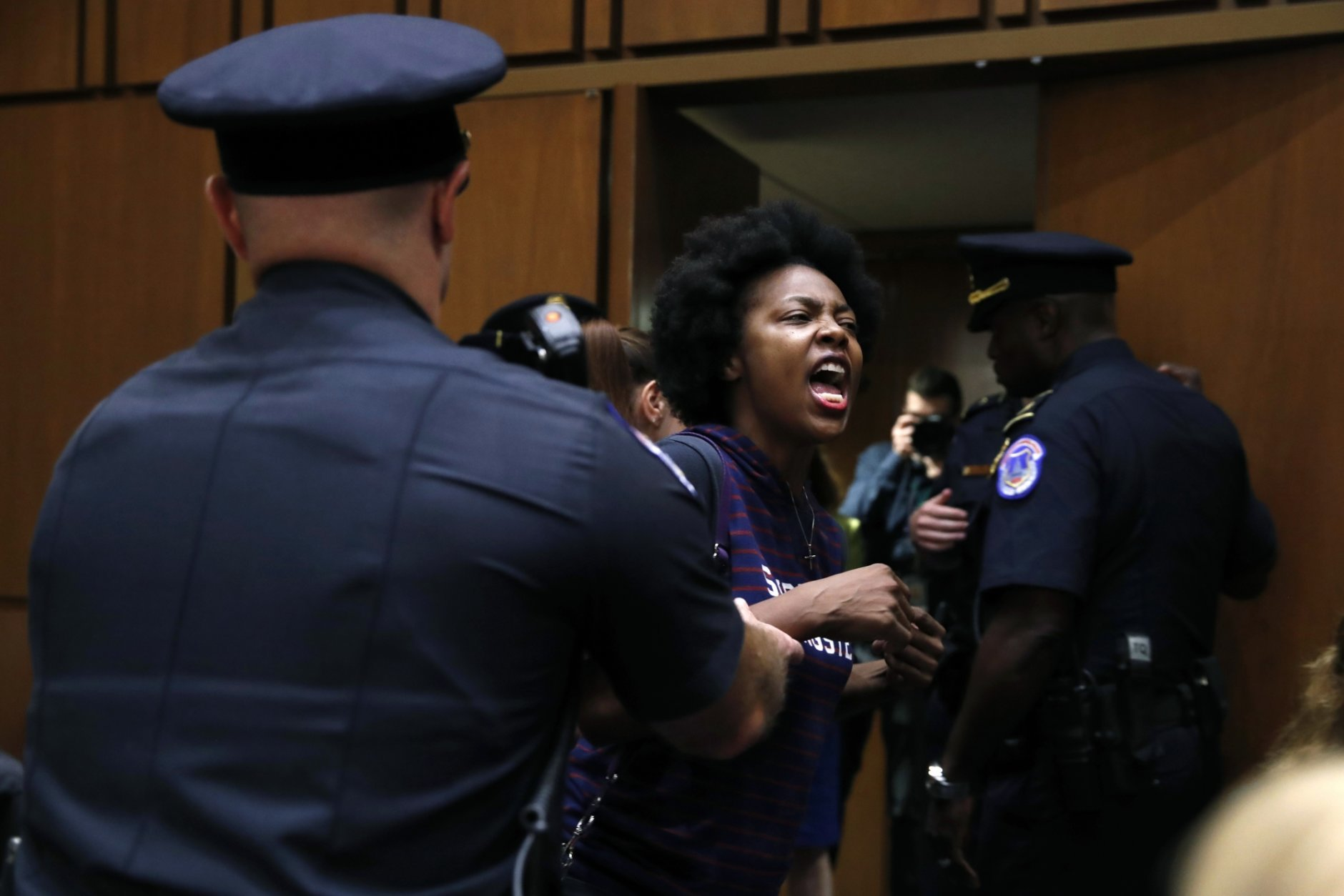 A protester against Supreme Court nominee Brett Kavanaugh is removed from his Senate Judiciary Committee confirmation hearing, on Capitol Hill, Tuesday, Sept. 4, 2018, in Washington. (AP Photo/Jacquelyn Martin)