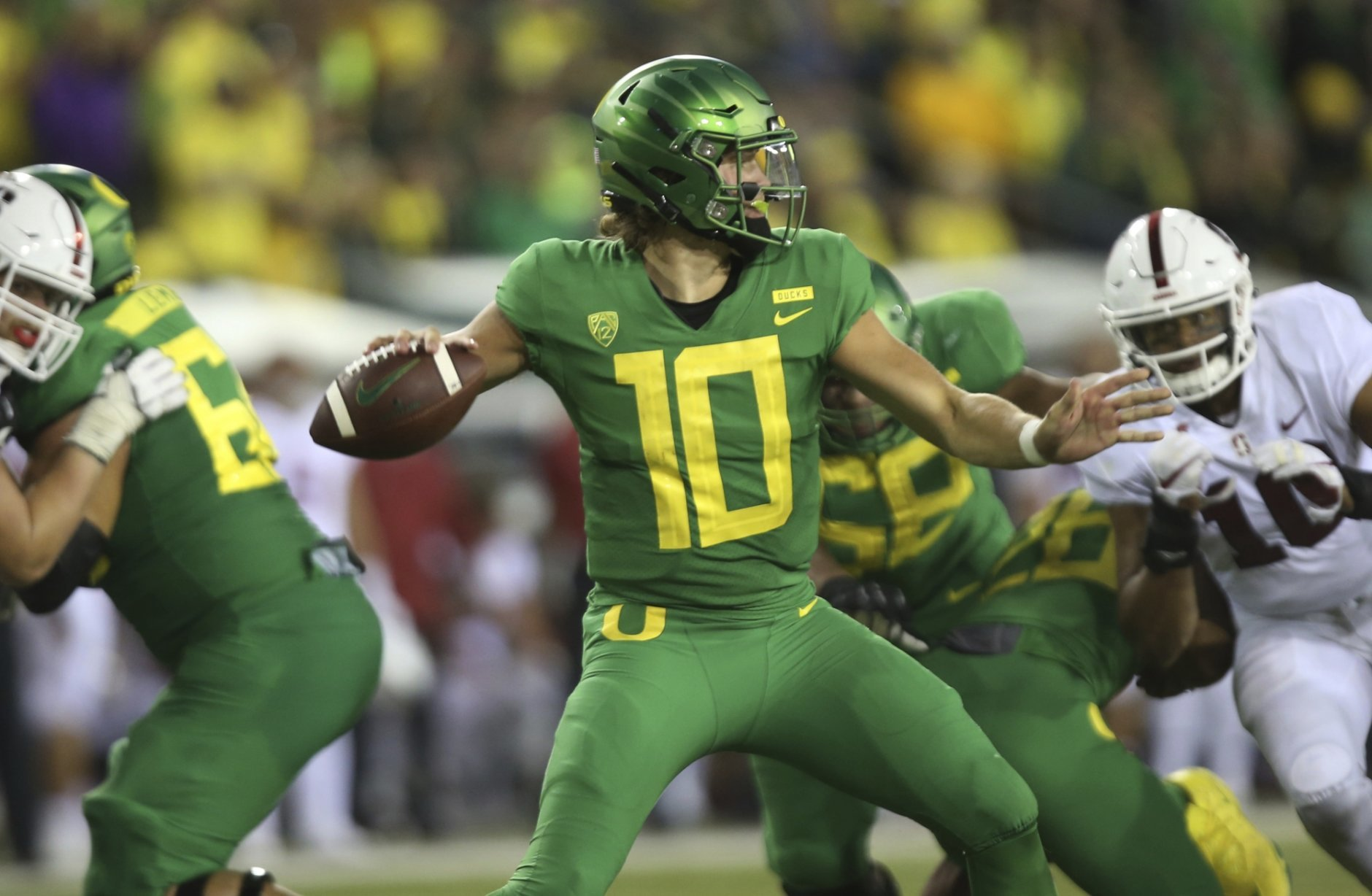 Oregon's Justin Herbert drops back to pass against Stanford during the third quarter an NCAA college football game Saturday, Sept. 22, 2018, in Eugene, Ore. (AP Photo/Chris Pietsch)