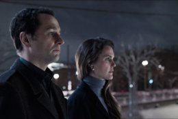 "This image released by FX shows Matthew Rhys, left, and Keri Russell in a scene from ""The Americans."" The program iss nominated for an Emmy on Thursday for outstanding drama series. The 70th Emmy Awards will be held on Monday, Sept. 17. Russell and Rhys are also nominated for outstanding actress and actor in a drama series. (FX via AP)"