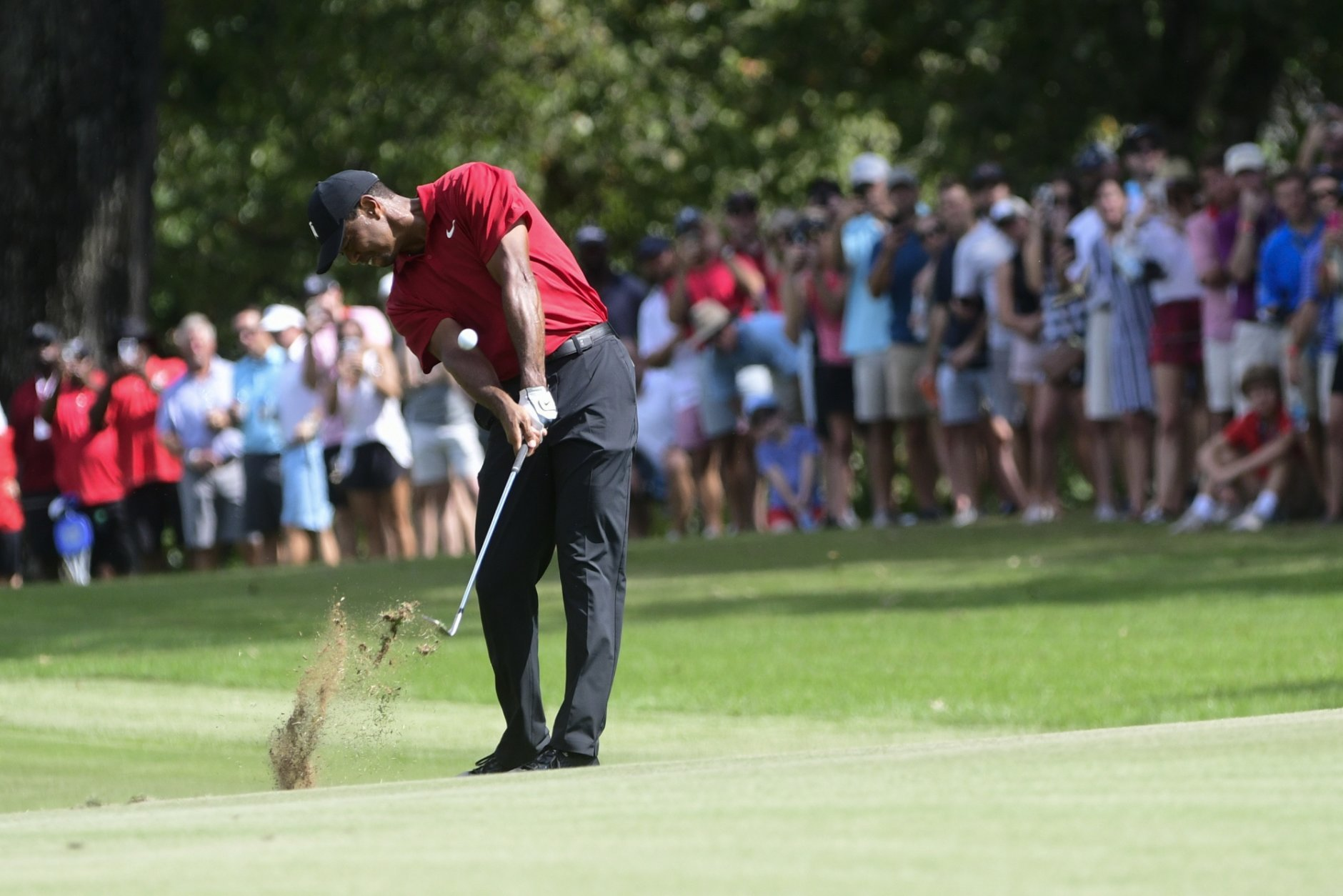 Tiger Woods hits from the fifth fairway during the final round of the Tour Championship golf tournament Sunday, Sept. 23, 2018, in Atlanta. (AP Photo/John Amis)