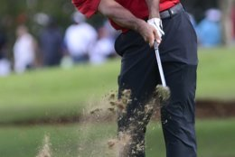 Tiger Woods hits from the third fairway during the final round of the Tour Championship golf tournament Sunday, Sept. 23, 2018, in Atlanta. (AP Photo/John Amis)