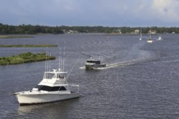 Boats make their way across Biloxi Back Bay in Biloxi, Miss.,as they evacuate to safe harbor, Monday, Sept. 3, 2018. Tropical Storm Gordon is expected to make landfall in Mississippi on Tuesday, possible as a Category 1 hurricane. (John Fitzhugh/The Sun Herald via AP)