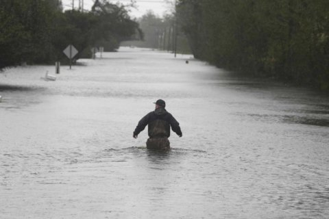 Florence breaks tide, rainfall records as it sits over N. Carolina