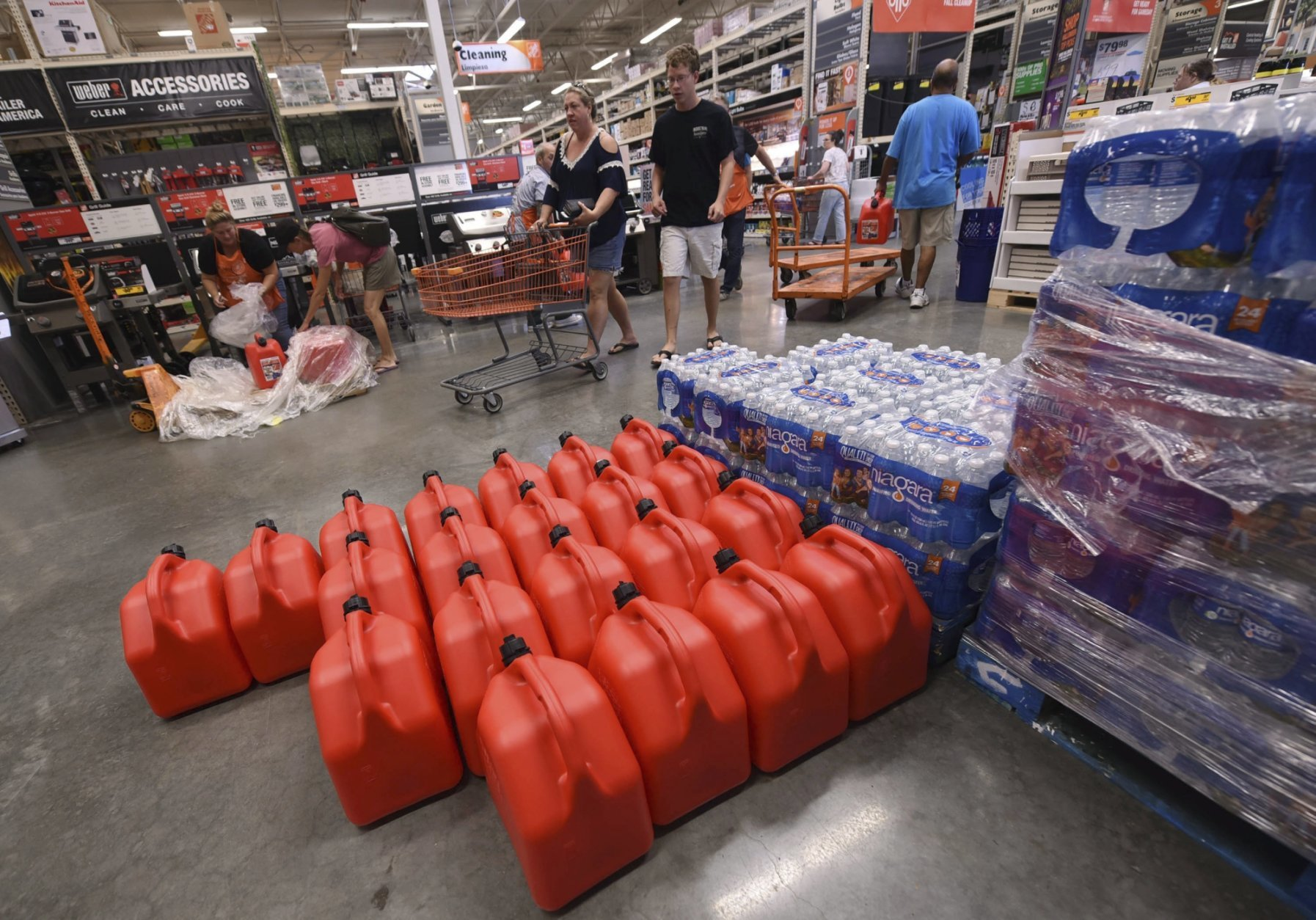 People buy supplies at The Home Depot on Monday, Sept. 10, 2018, in Wilmington, N.C. Florence rapidly strengthened into a potentially catastrophic hurricane on Monday as it closed in on North and South Carolina, carrying winds and water that could wreak havoc over a wide stretch of the eastern United States later this week. (Ken Blevins/The Star-News via AP)