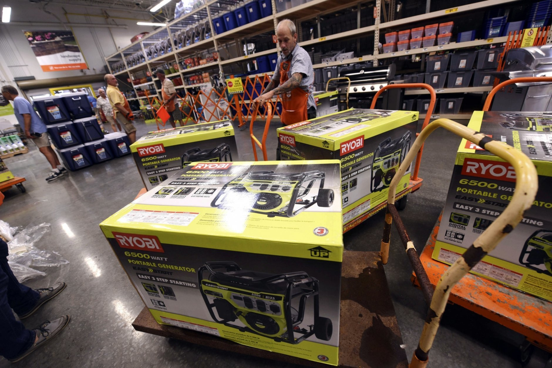 Brian Franklin prepares more generators for sale as people buy supplies at The Home Depot on Monday, Sept. 10, 2018, in Wilmington, N.C. Hurricane Florence rapidly strengthened into a potentially catastrophic hurricane on Monday as it closed in on North and South Carolina, carrying winds and water that could wreak havoc over a wide stretch of the eastern United States later this week. (Ken Blevins/The Star-News via AP)