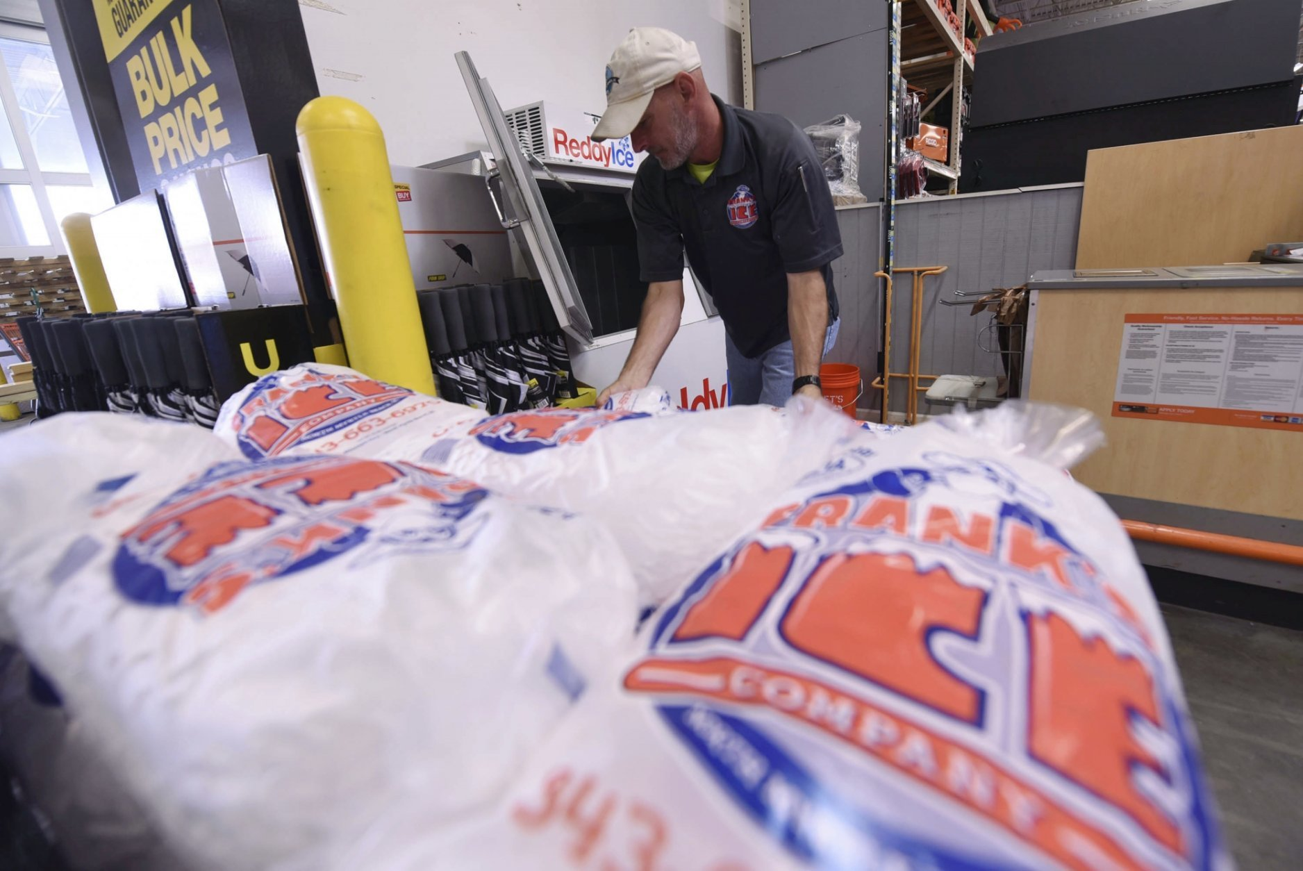 Mike Herring with Frank's Ice Company unloads another pallet of ice as people buy supplies at The Home Depot on Monday, Sept. 10, 2018, in Wilmington, N.C. Hurricane Florence rapidly strengthened into a potentially catastrophic hurricane on Monday as it closed in on North and South Carolina, carrying winds and water that could wreak havoc over a wide stretch of the eastern United States later this week. (Ken Blevins/The Star-News via AP)