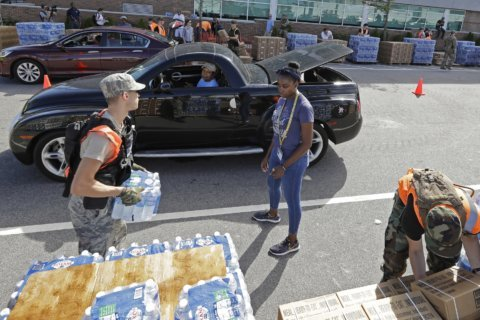 The Latest: Ferry services resuming in North Carolina