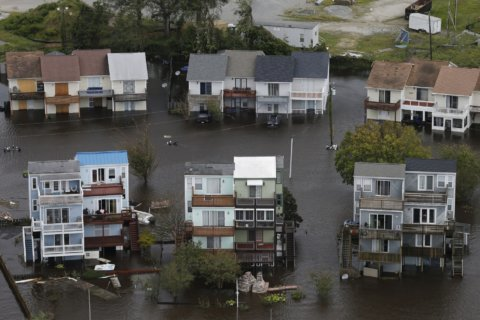 The Latest: Child swept away by floodwaters
