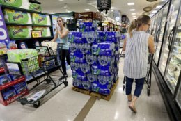 People shop at the Harris Teeter, filling up on water and supplies as Hurricane Florence becomes a threat to the coast Monday, Sept. 10, 2018, in Charleston, S.C. (Grace Beahm Alford/The Post And Courier via AP)