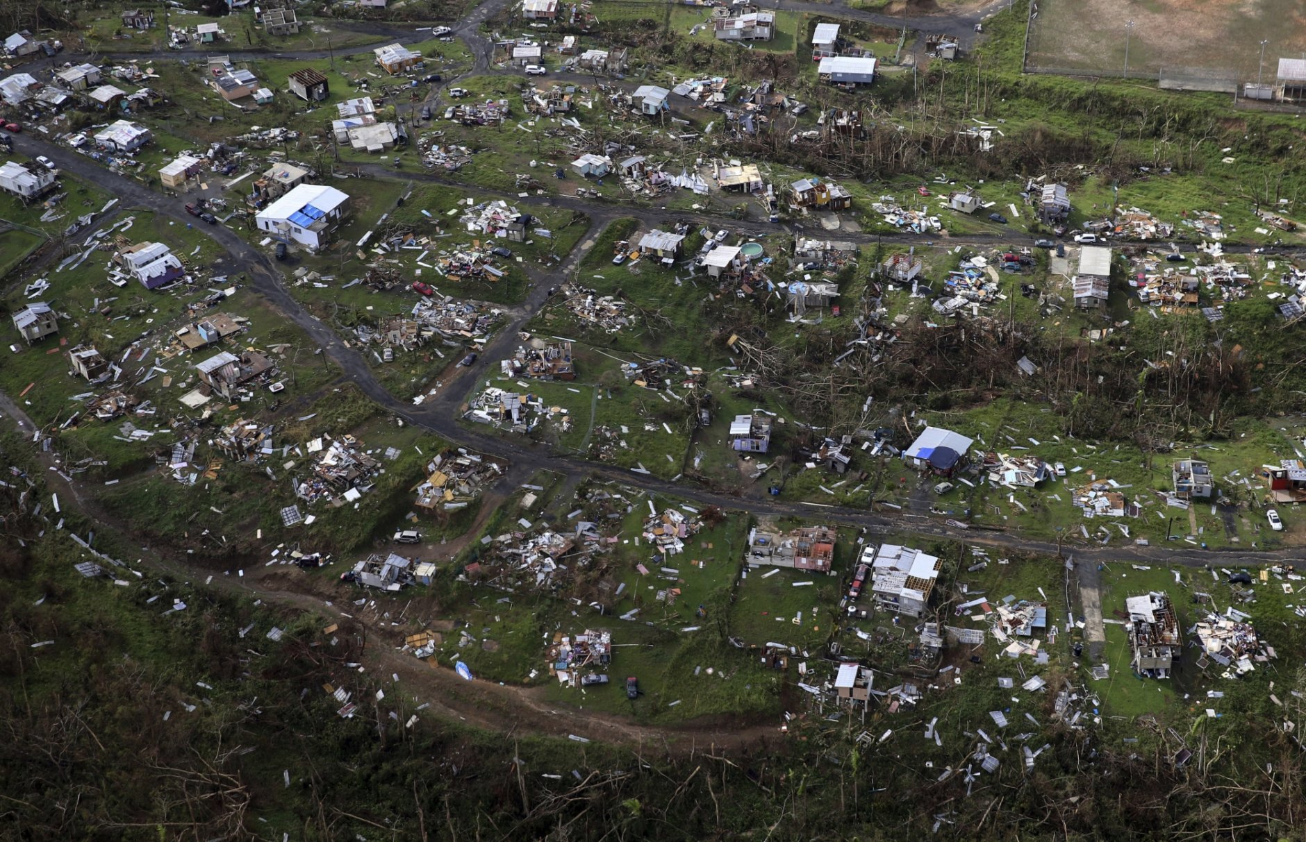 FILE - In this Sept. 28, 2017, file photo, homes and other buildings destroyed by Hurricane Maria lie in ruins in Toa Alta, Puerto Rico. Top Florida Republicans have been quick to say President Donald Trump is wrong about the death toll in Puerto Rico. (AP Photo/Gerald Herbert, File)