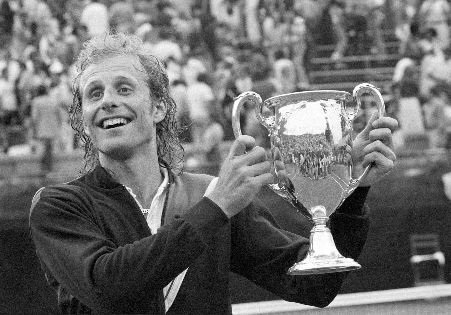 Vitas Gerulaitis holds up his trophy cup after winning the $300,000 Forest Hills Invitational Tournament in Queens, New York, Sunday, July 16, 1978.  Gerulaitis won the $100,000 first prize after defeating his opponent Ilie Nastase, 6-2, 6-0.  (AP Photo/Dave Pickoff)