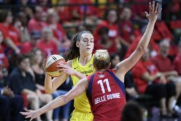 Seattle Storm forward Breanna Stewart, back, holds the ball against Washington Mystics forward Elena Delle Donne (11) during the first half of Game 3 of the WNBA basketball finals, Wednesday, Sept. 12, 2018, in Fairfax, Va. (AP Photo/Nick Wass)