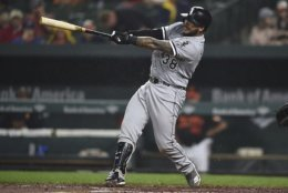 Chicago White Sox Omar Narvaez connects for a two-run home run against the Baltimore Orioles in the third inning of a baseball game, Friday, Sept. 14, 2018, in Baltimore. (AP Photo/Gail Burton)