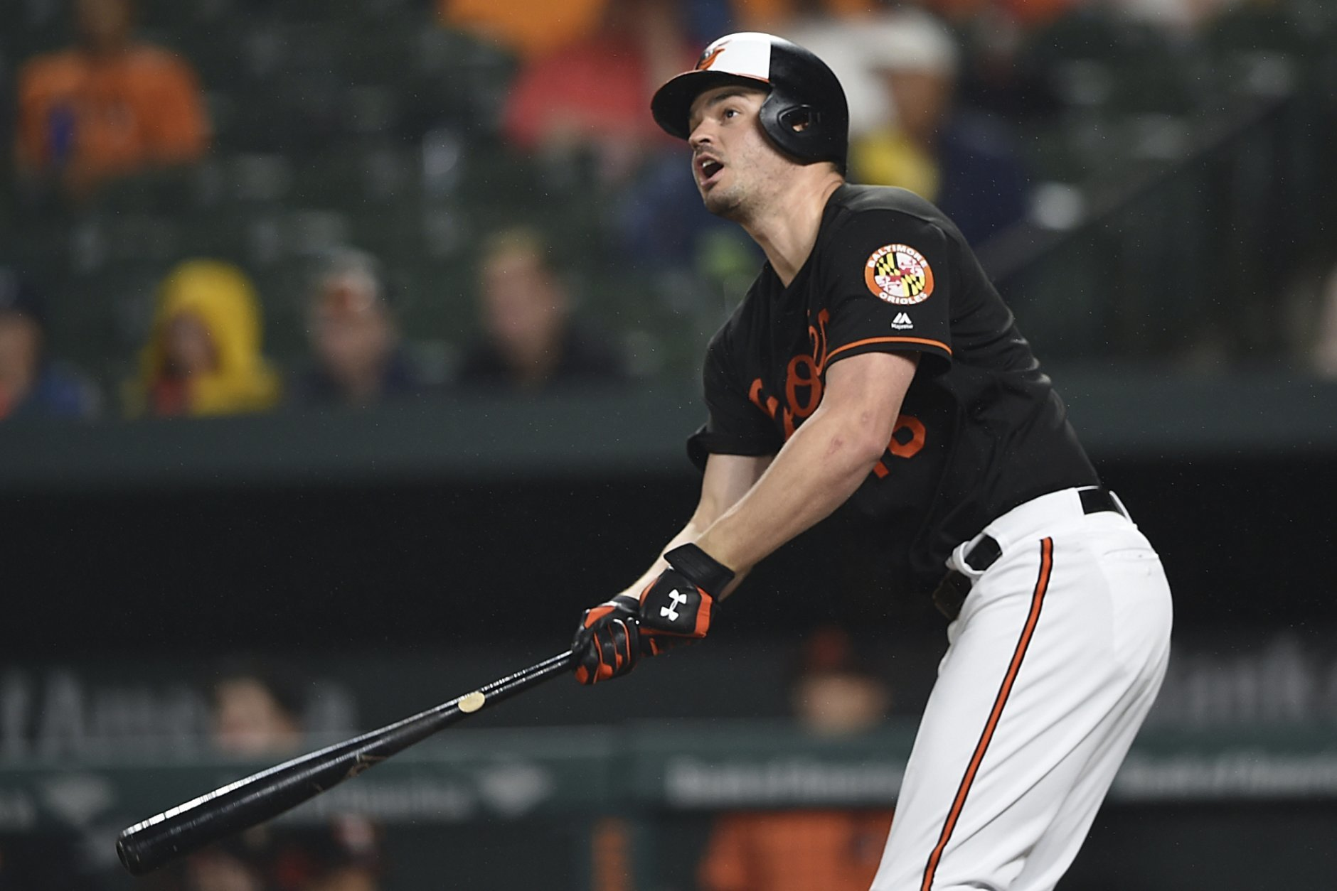 Baltimore Orioles' Trey Mancini follows through on a solo home run against the Chicago White Sox in the fourth inning of a baseball game, Friday, Sept. 14, 2018, in Baltimore. (AP Photo/Gail Burton)