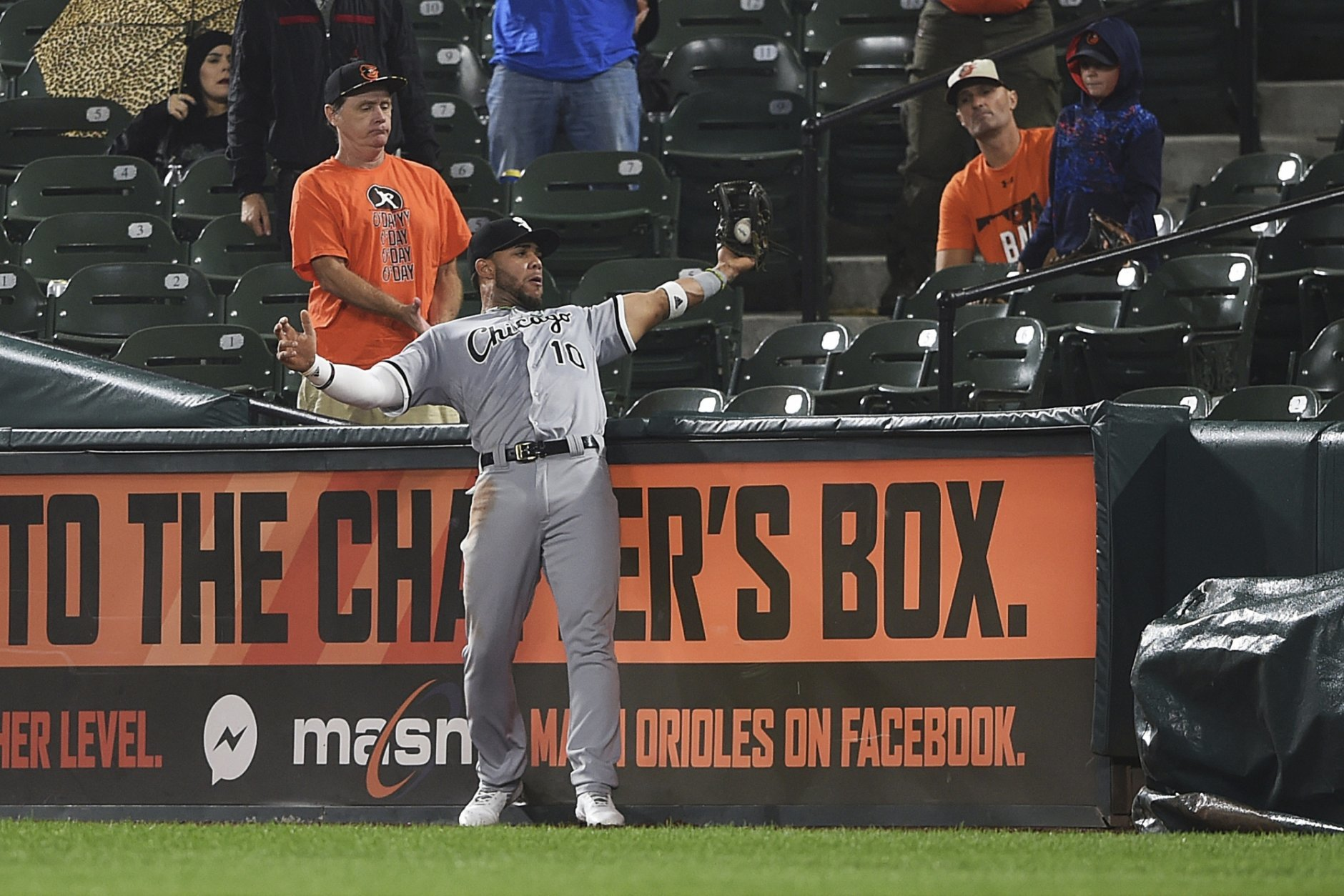 Chicago White Sox second baseman Yoan Moncada catches a ball in foul territory hit by Baltimore Orioles' DJ Stewart in the second inning of a baseball game, Friday, Sept. 14, 2018, in Baltimore. (AP Photo/Gail Burton)
