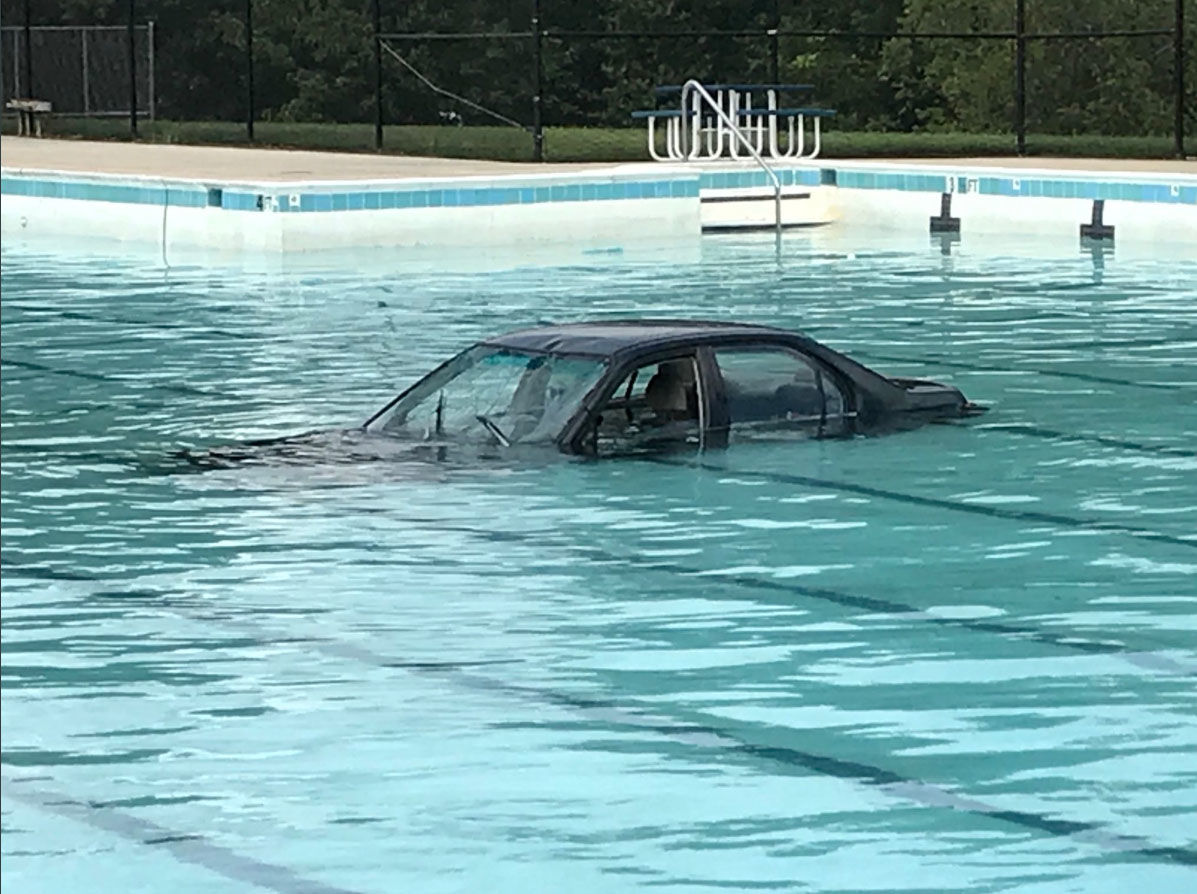 A car plunges into a community pool in a Montgomery County community center on Saturday, Sept. 15, 2018. (Courtesy Montgomery County Fire and Rescue)