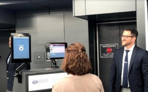 Passengers at Dulles International Airport use the new facial recognition software. (Credit Mike Murillo/WTOP)