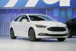 The 2017 Ford Fusion ranks No. 5 hottest models thieves want to get their hands on. The Ford Fusion hybrid is displayed at the North American International Auto Show, Monday, Jan. 11, 2016, in Detroit. (AP Photo/Carlos Osorio)