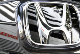"""The 1997 Honda Accord was the No. 2 most stolen car overall. In this photo taken Jan. 21, 2010, Honda Motor Co.'s headquarter building is reflected on Honda's car logo in Tokyo, Japan. Honda is aiming to double its global auto sales to more than 6 million vehicles over the next five years as the Japanese automaker gears up for ambitious growth after bouncing back from last year's disasters. """"We have now reached the stage of going on the offensive,"""" Honda President Takanobu Ito told reporters Friday, Sept. 21, 2012 as he announced his worldwide target for the fiscal year ending March 2017. The automaker sold 3.1 million vehicles for the fiscal year through March 2012. (AP Photo/Shizuo Kambayashi)"""