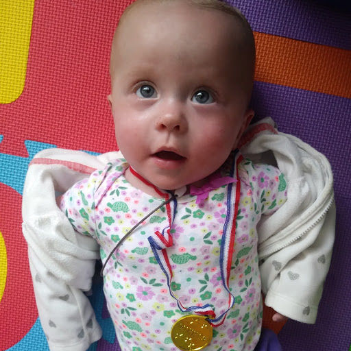 Julia pictured in mid-August with her oxygen off, wearing a medal she got from Children's National for her great progress. (Courtesy Abigail Rueger)