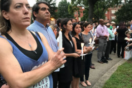 A crowd gathers in D.C.'s Logan Circle on Thursday, Sept. 20, 2018, during a vigil for Wendy Martinez, 35, who was stabbed to death while out for a run (WTOP/Michelle Basch)