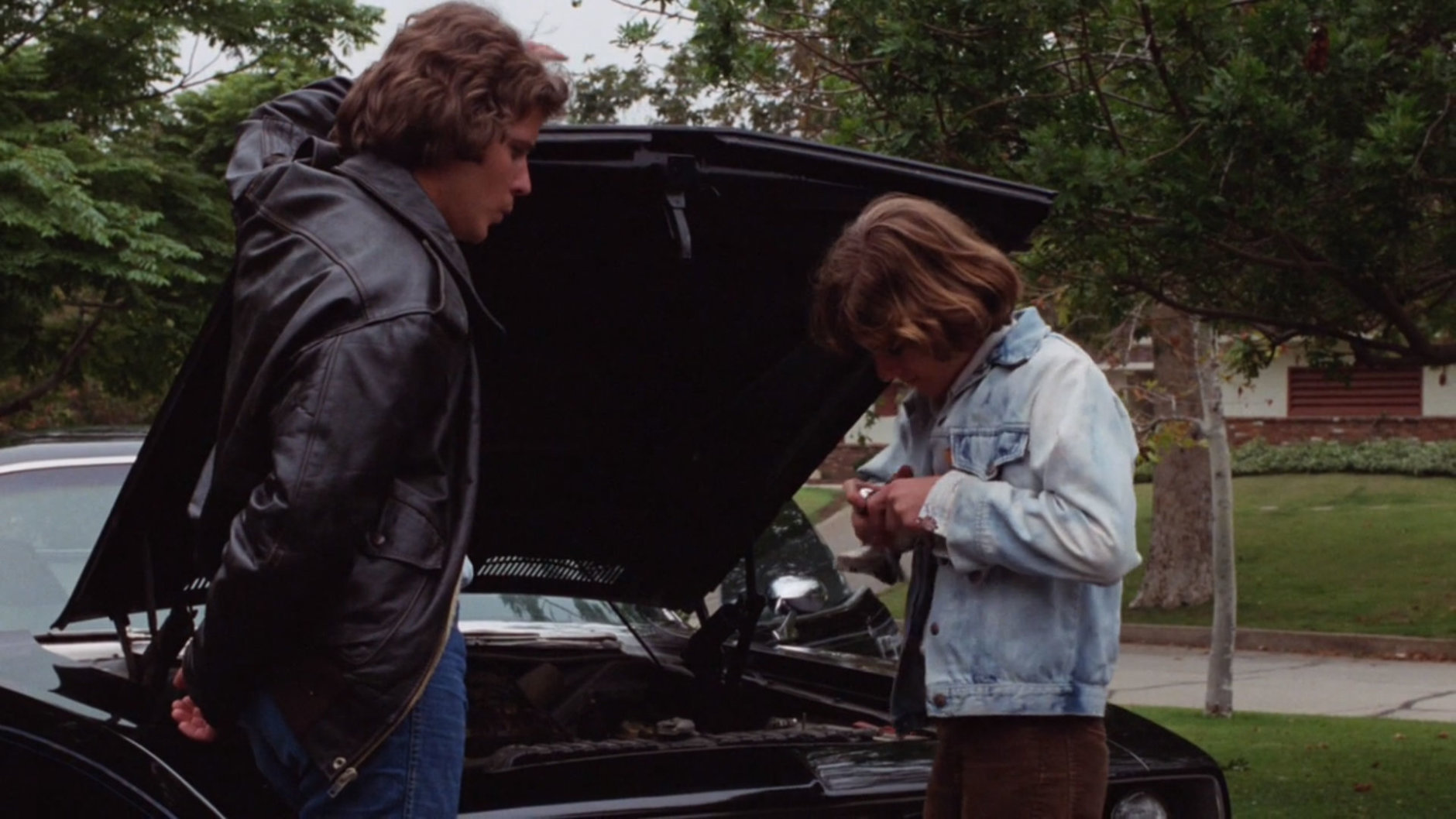 Jody (Bill Thornbury) and Mike (A. Michael Baldwin) work on the iconic (Hemi)Cuda. (Courtesy Silver Sphere Productions)