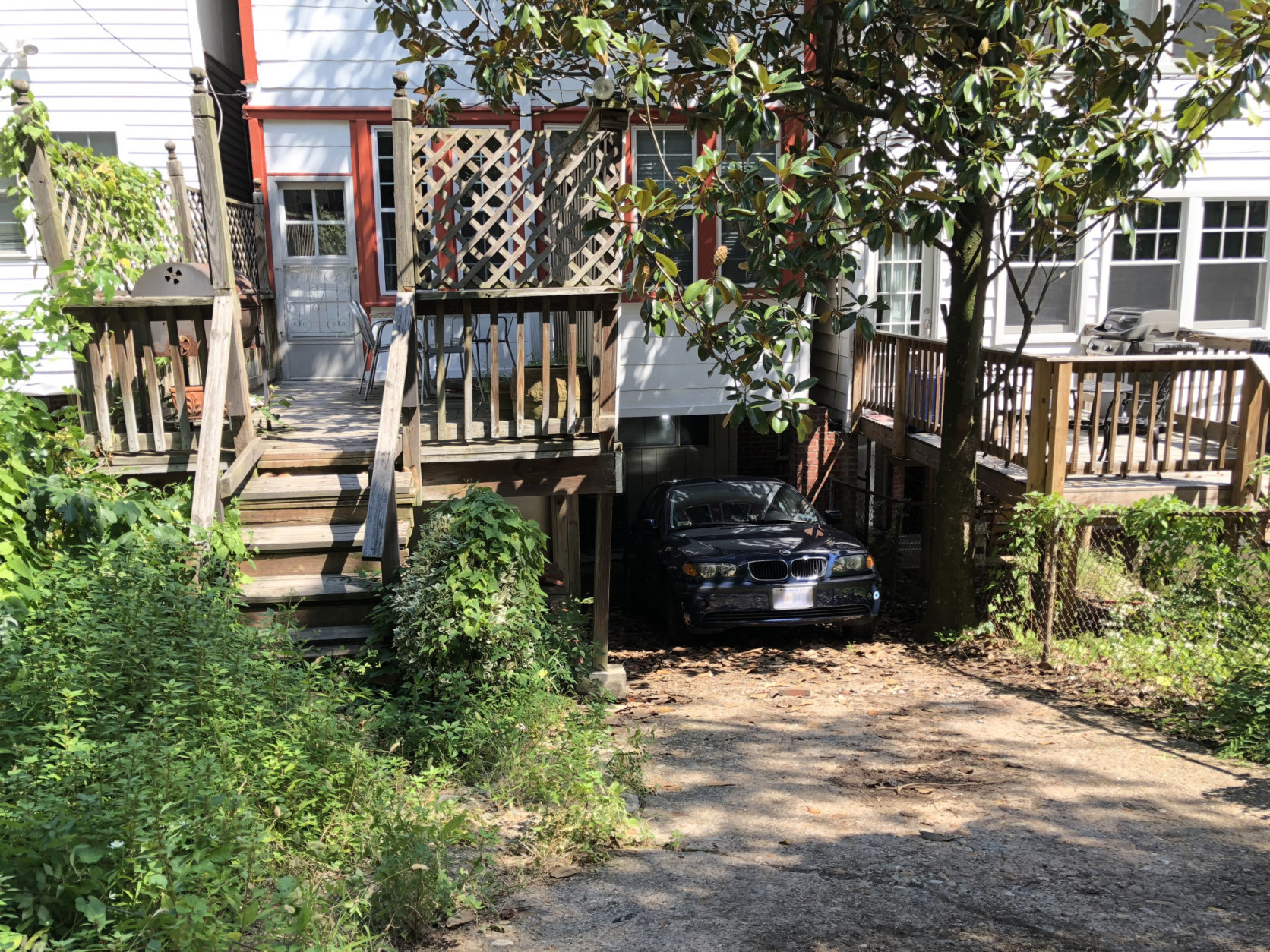 Outside a Glover Park home, the car that pinned a man who died still sits at the scene of the apparent accident. (WTOP/Kristi King)