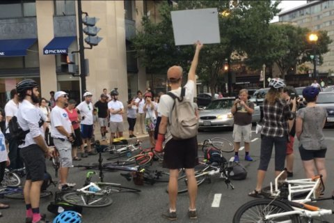 Traffic halted through Dupont Circle in vigil for man killed on scooter