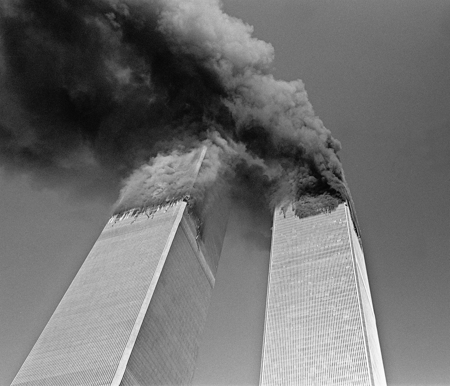 Smoke billows from the twin towers of the World Trade Center in New York Tuesday Sept. 11, 2001. In one of the most horrifying attacks ever against the United States, terrorists crashed two airliners into the World Trade Center in a deadly series of blows that brought down the twin 110-story towers. (AP Photo/Gulnara Samoilova)