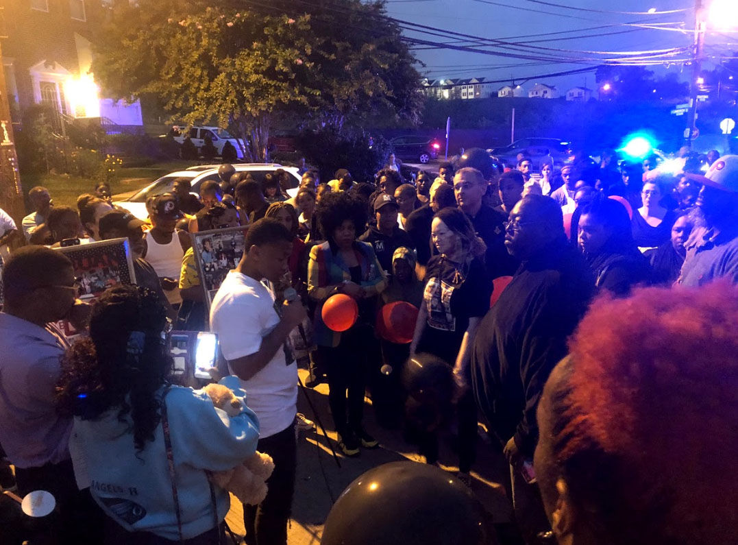 Neighbors gathered Thursday, Sept. 13, 2018, at a vigil for slain D.C. teenager TaQuan Pinkney. (WTOP/Mike Murillo)