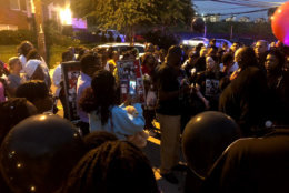 The community where slain teenager TaQuan Pinkney lived come together Thursday, Sept. 13, 2018, to bring an end to the violence which has plagued the neighborhood. (WTOP/Mike Murillo)