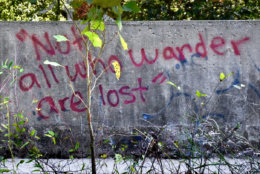 """Inscribed on the parapet of Jug Bridge's successor is the text """"not all who wander are lost."""" The line, borrowed from J.R.R. Tolkien, offers a reminder that not all ghosts roads are forgotten. (WTOP/Dave Dildine)"""
