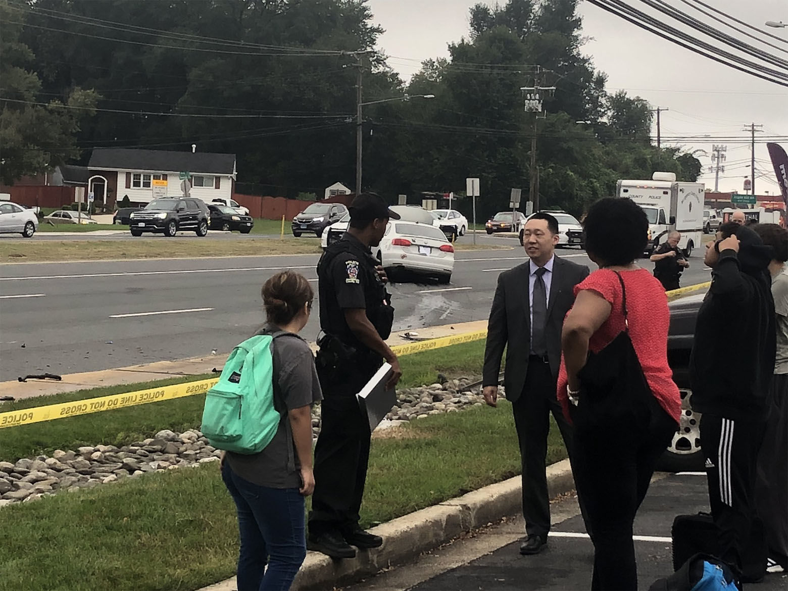 Four Kennedy High School students waiting for a school bus in Aspen Hill, Maryland, Tuesday morning were struck by a car that careened onto the sidewalk off Georgia Avenue. (WTOP/Melissa Howell)