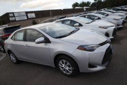 In this Sunday, June 24, 2018, photograph, unsold 2018 Corolla sedans sit at a Toyota dealership in Englewood, Colo. (AP Photo/David Zalubowski)