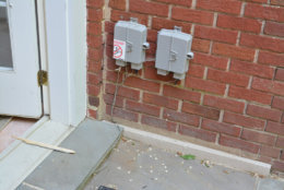 The phone lines to the house seen here outside the door to the house's kitchen were cut. (Courtesy U.S. Attorney's Office for D.C.)