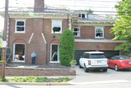 The Savopoulos house is seen in this crime scene photo from D.C. police. Fire officials testified they broke out many of the house's windows to ventilate the fire that raged on the home's second floor. (Courtesy U.S. Attorney's Office for D.C.)