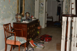 The scene in the home's entryway appears to show signs of a struggle, prosecutors said: An overturned bag belonging to Savvas Savopoulos; scattered schools books belonging to his 10-year-old son, Philip. (Courtesy U.S. Attorney's Office for D.C.)