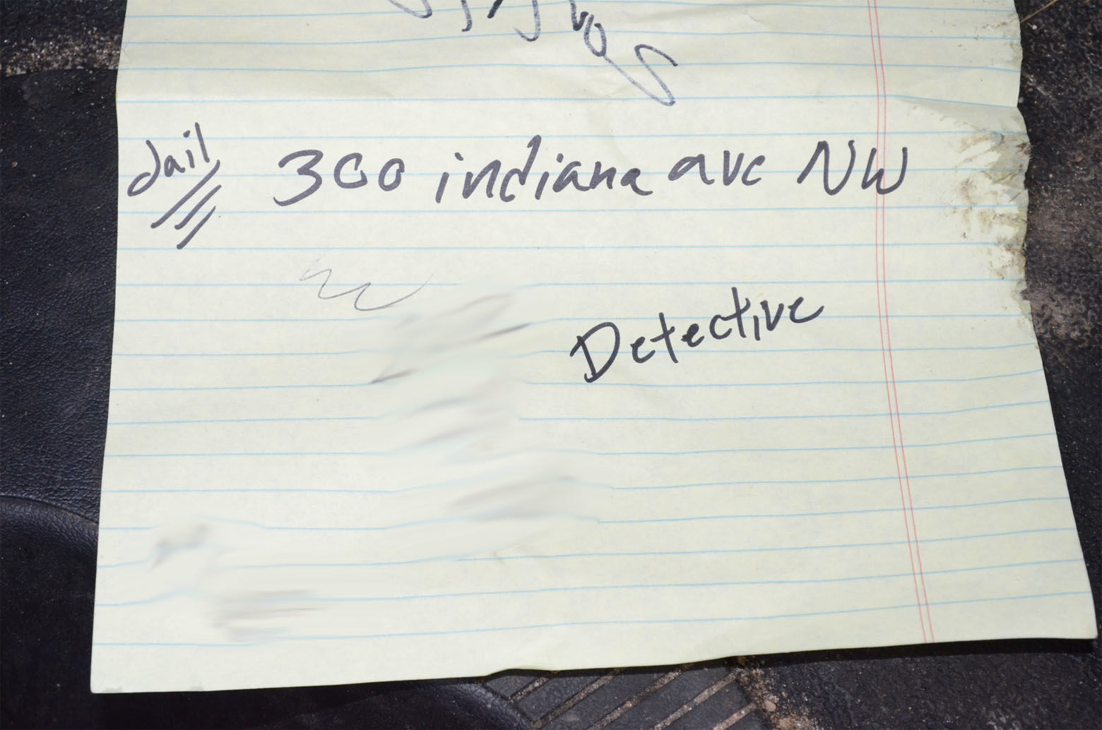 This piece of paper was found by police the night Daron Wint was arrested. Darrell Wint, Daron Wint's younger brother, testified he was on the phone with police helping to turn him in when their vehicles were swarmed by U.S. Marshals. The scrap of paper contains the address for the D.C. jail.  A phone number scribbled next to the word detective (blurred out in this photograph) was the phone number for D.C. Det. Jeff Owens, the lead detective investigating the killings of the Savopoulos family and Vera Figueroa. (Courtesy U.S. Attorney's Office for D.C.)
