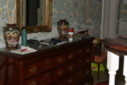 Prosecutors said Amy Savopoulos was out on a Starbucks run when Daron Wint got inside the house. When she returned home, he took her captive alongside her son and Vera Figueroa, one of the family's housekeepers. A Starbucks cup is seen on a bureau in the home's entryway. (Courtesy U.S. Attorney's Office for D.C.)
