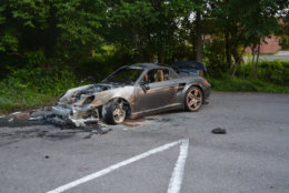 The blue Porsche belonging to Amy Savopoulos was driven from the family's house after the mansion was set ablaze. It was later found burning in the back of a church parking lot in New Carrollton, Maryland. Inside, investigators found a construction vest with Daron Wint's DNA on it. (Courtesy U.S. Attorney's Office for D.C.)