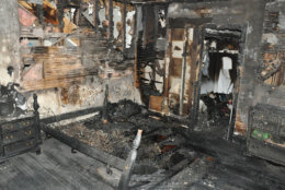 The burned-out upstairs bedroom where the body of 10-year-old Philip Savopoulos was found. The fire burned so hot, it burned through the floorboards. Fire investigators told the jury the fire started on the bed. (Courtesy U.S. Attorney's Office for D.C.)