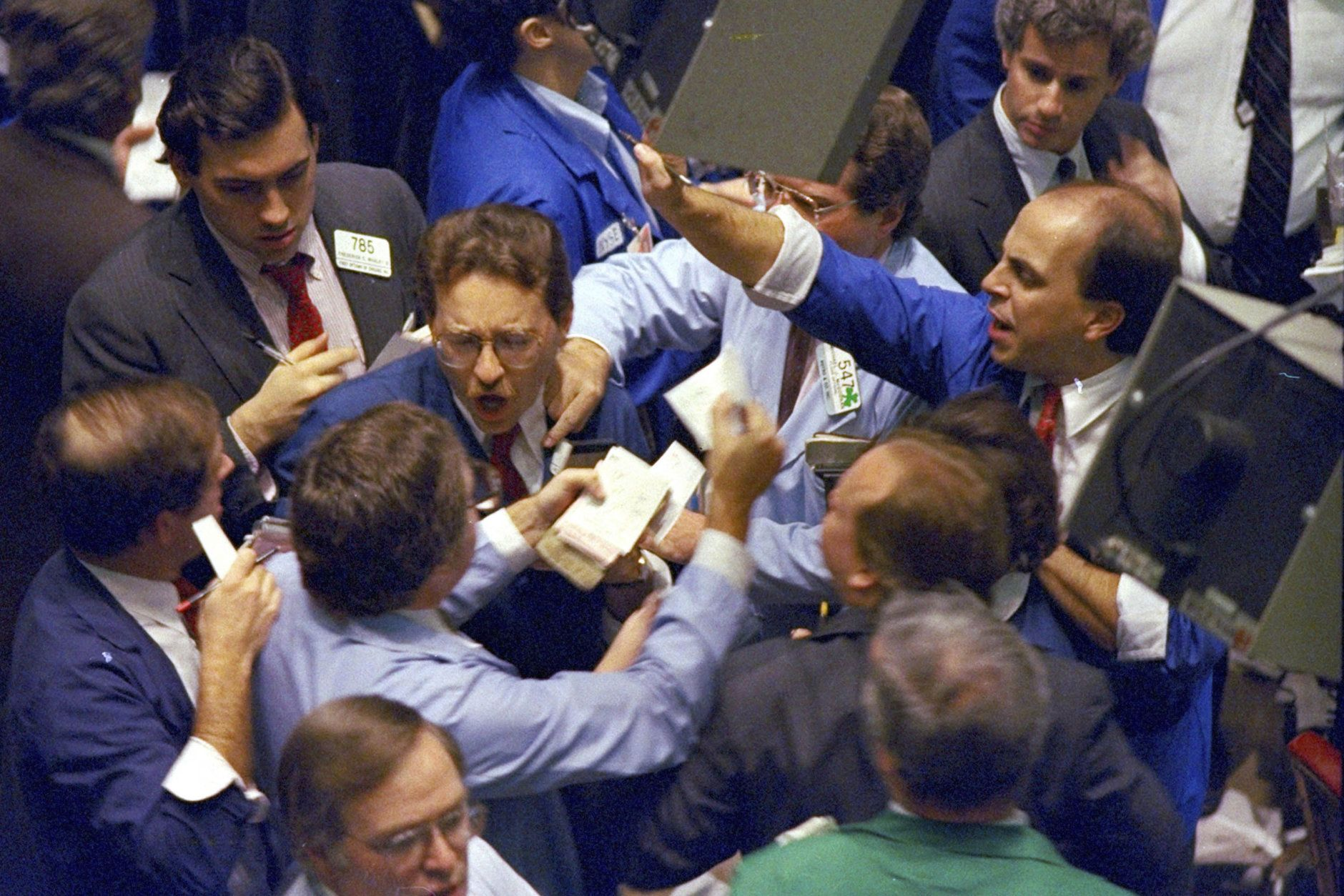 """FILE - In this Oct. 19, 1987, file photo, traders work on the floor of the New York Stock Exchange. What if the stock market plunged 20 percent tomorrow? The question may seem absurd when the market is in the midst of one of its calmest runs in history and at record highs. But it's what investors had to deal with 30 years ago, when """"Black Monday"""" blasted stocks on Oct. 19, 1987. (AP Photo/Peter Morgan, File)"""