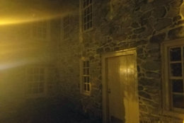 The Old Stone House at night is not a welcoming sight. (WTOP/Will VItka)