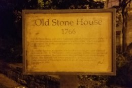 The sign outside the Old Stone House. (WTOP/Will Vitka)