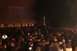 Mourners gather Monday night outside Adas Israel Congregation in D.C.'s Cleveland Park neighborhood. (WTOP/Lisa Weiner)